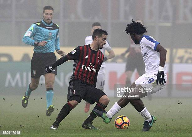 Suso of AC Milan is challenged by Franck Kessie of Atalanta BC during the Serie A match between AC Milan and Atalanta BC at Stadio Giuseppe Meazza on...
