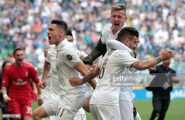 Suso of AC Milan with his teammate Juraj Kucka and Lucas Ocampos celebrates at the end of the Serie A match between FC Internazionale and AC Milan at...