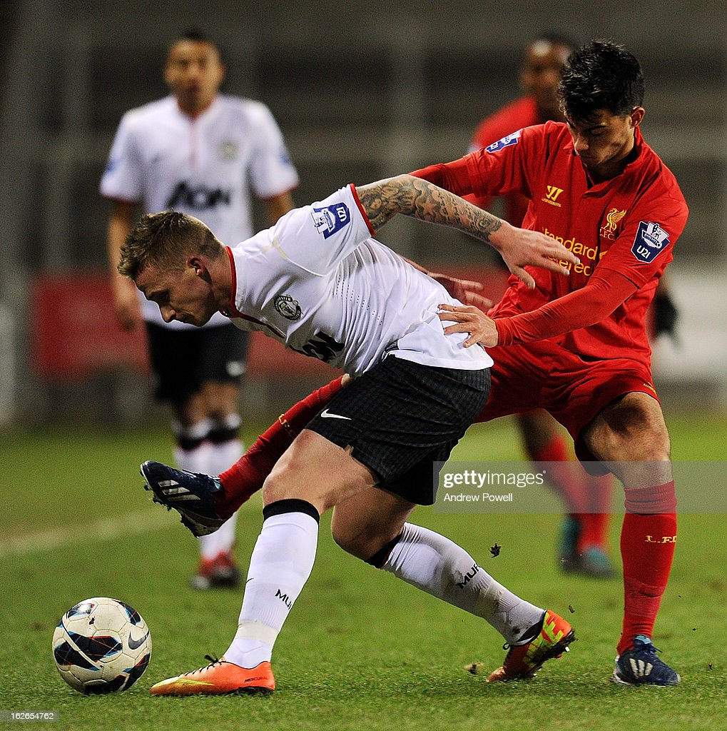 Suso of Liverpool competes with Alex Buttner of Manchester United Reserves during the Barclays Premier Reserve League match between Liverpool Reserves and Manchester United at Langtree Park on February 25, 2013 in St Helens, England.