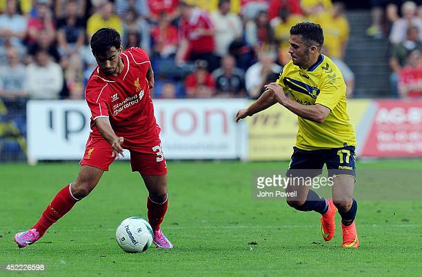 Suso of Liverpool competes with Riza Durmisi of Brondby IF during the Preseason friendly match between Brondby IF and Liverpool FC at Brondby Stadium...