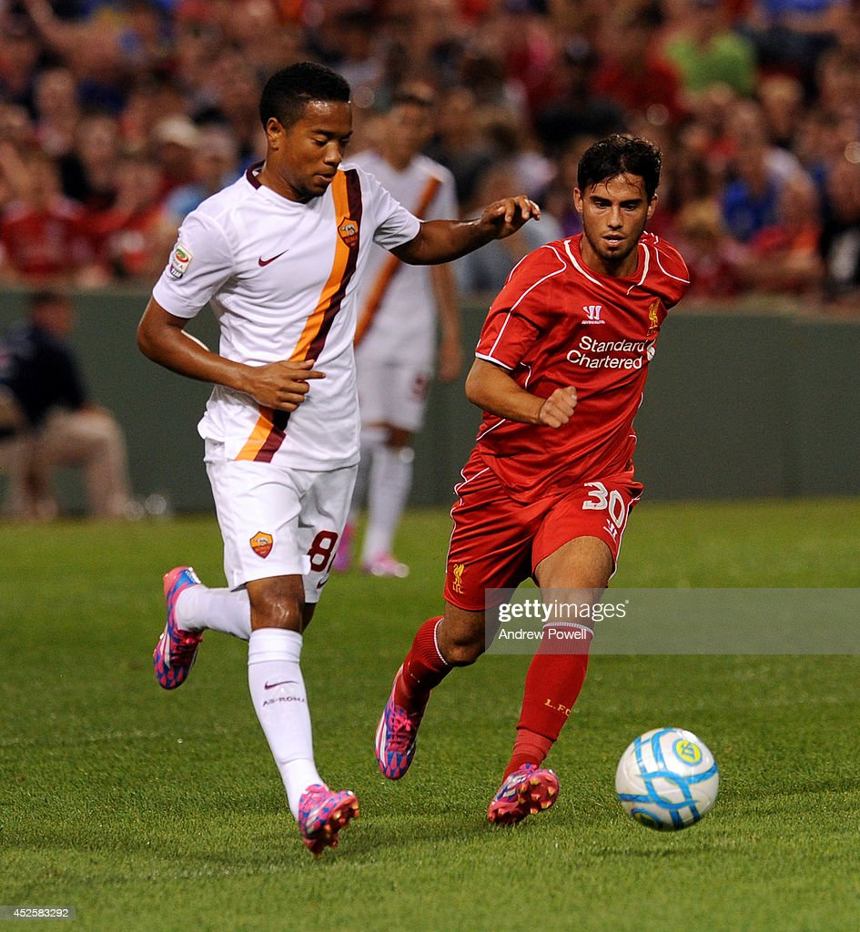 Suso of Liverpool competes with Vrby Vittono Dicgo Emanucison of AS Roma during the pre-season friendly match between Liverpool FC and AS Roma at Fenway Park on July 23, 2014 in Boston, Massachusetts.