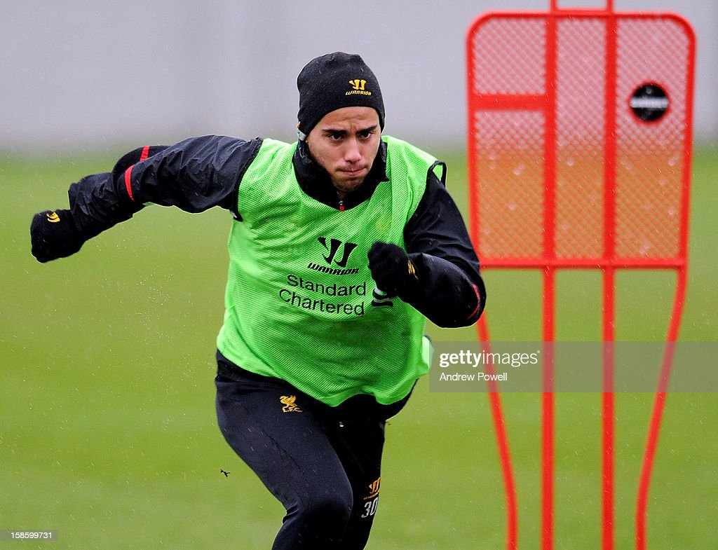 Suso of Liverpool in action during a training session at Melwood Training Ground on December 20, 2012 in Liverpool, England.