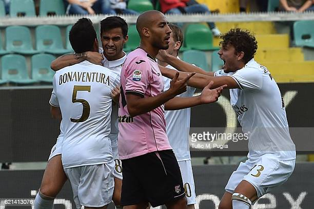 Suso of Milan celebrates with team mates after scoring the opening goal during the Serie A match between US Citta di Palermo and AC Milan at Stadio...