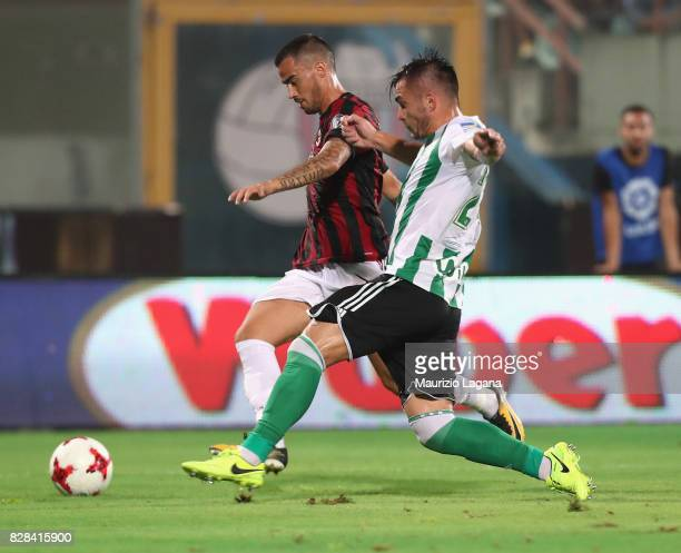 Suso of Milan competes for the ball with Alin Tosca of Real Betis during the PreSeason Friendly match between AC Milan and Villareal at Stadio Angelo...