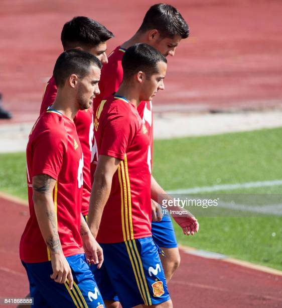 Suso of Spain Lucas Vazquez of Spain Alvaro Morata of Spain and Marco Asensio of Spain looks on during a training session on August 29 2017 in Madrid...