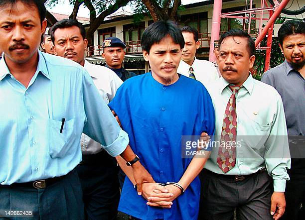 A suspect in the recent Bali bombings Bali bombing Amrozi is guarded by police near the prosecutor office in Denpasar 07 March 2003The key suspect is...