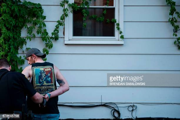 A suspect is searched on April 19 2017 in Huntington West Virginia A needle was found on him Huntington the city in the northwest corner of West...
