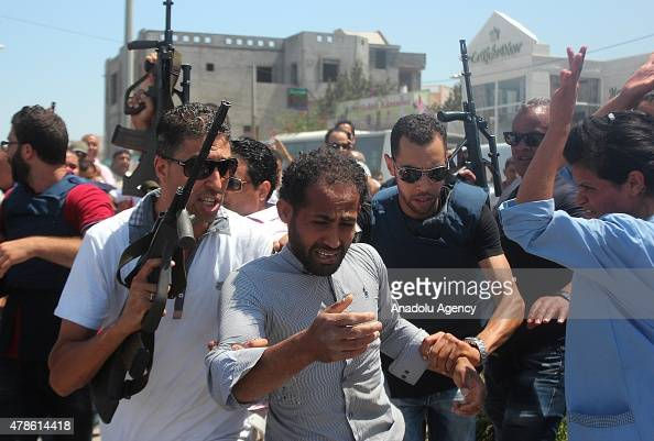 A suspect man is arrested after an armed attack on a tourist hotel in Sousse east Tunisia left at least 27 people dead including foreigners and...