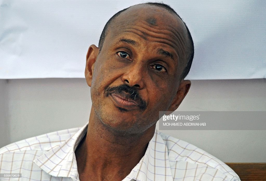 Suspected Abdiweli Mohamud Macow, a former airport security officer, who was found guilty of masterminding the Daallo Airlines bomb attack claimed by the Al-Qaeda-linked Shebab, looks on during a Somali military court in Mogadishu, on May 30, 2016. 'Abdiweli Mohamud together with Areys Hashi Abdi, who is absent, were found guilty as charged. The court sentences them to life imprisonment,' said Lieutenant Colonel Hassan Nur Shute, head of the military court on May 30. Both men were also found guilty of being members of the Shebab. The February 2 blast left a metre-wide (three-foot) hole in the fuselage of the Daallo Airlines plane shortly after it took off from Somalia's main airport in Mogadishu, killing only the suspected bomber and forcing an emergency landing. ABDIWAHAB