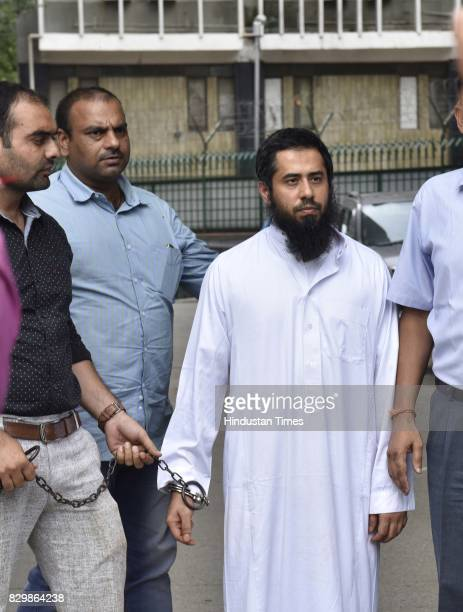 Suspected AlQaeda fugitive Syed Mohammed Zishan Ali brought back from Saudi Arabia to India on August 10 2017 in New Delhi India Zishan who has been...