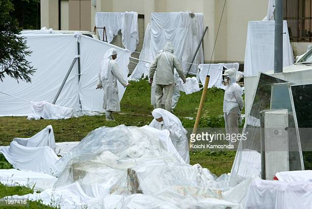 Suspected cult group members of 'Pana Wave Laboratory' in white clothes to help neutralize the waves that are harming their leader's health...