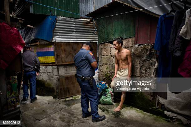 A suspected drug user is searched and arrested during a Tokham Operation in the Tali Papa branguay in Quezon city