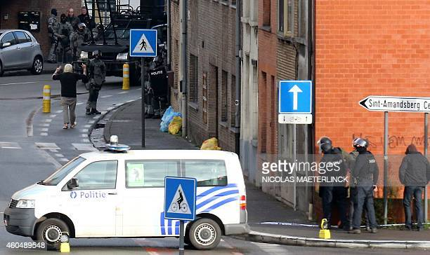 A suspected hostage taker surrenders to Belgian police after four armed men invaded an apartment in the Pilorijnstraat near Ghent on December 15 2014...
