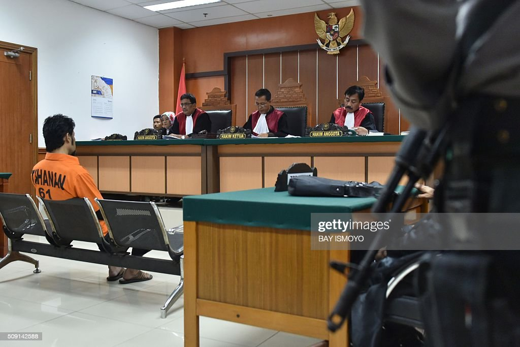 Suspected Islamic radical identified as Muhammad Fachry (L, seated), appears before the judges at a court in Jakarta on February 9, 2016. An Indonesian court February 9 sentenced seven men to between three and five years in jail for supporting the Islamic State group, weeks after the extremist network launched a deadly assault on Jakarta. AFP PHOTO / Bay ISMOYO / AFP / BAY ISMOYO