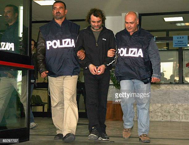 Suspected mafia boss Antonio Pelle is escorted by policemen after being arrested in southern Calabria on October 16 2008 Pelle who is implicated in...