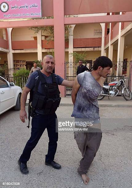 A suspected member of the Islamic State group is detained by Iraqi Kurdish forces in the southern Domiz neighbourhood of Kirkuk on October 21 after...