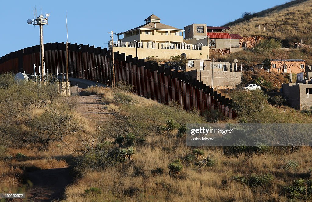 A suspected narco obvervation house stands on the Mexican side of the USMexico border fence on December 9 2014 near Nogales Arizona With increased...