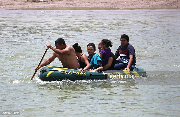 A suspected smuggler allegedly brings undocumented Salvadorian immigrants most of them minors across the Rio Grande from Mexico into the United...