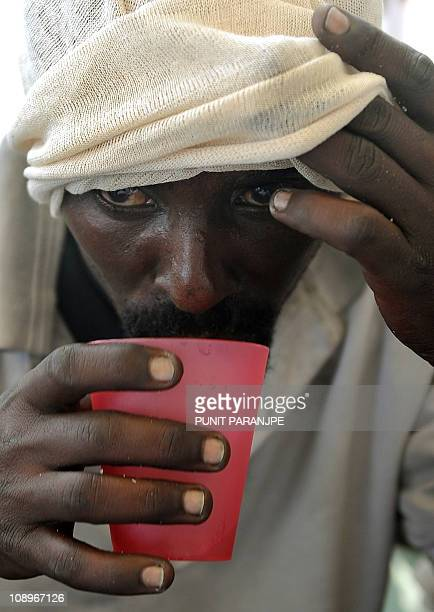 A suspected Somali pirate drinks water during a media interaction on board an Indian Coast guard ship off the coast of Mumbai on February 10 2011...