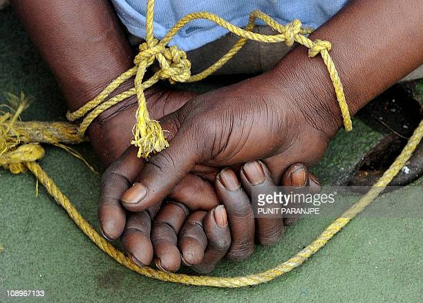 A suspected Somali pirates hands are tied behind his back during a media interaction on board an Indian Coast guard ship off the coast of Mumbai on...