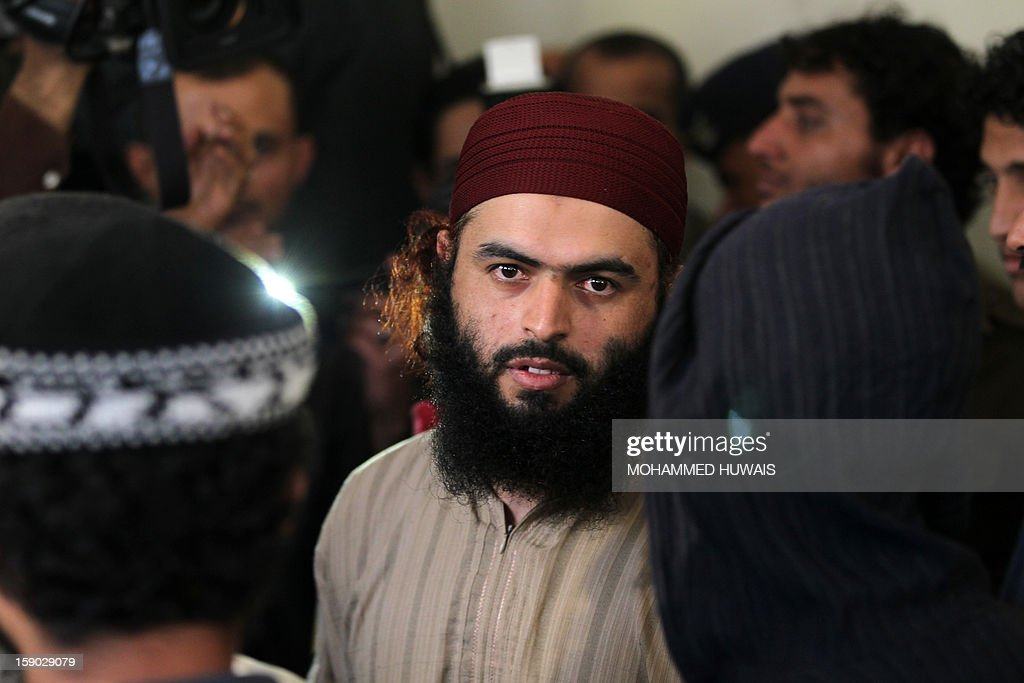 A suspected Yemeni al-Qaeda militant arrives for his sentencing hearing on January 6, 2013 at the state security court in the Yemeni capital Sanaa.
