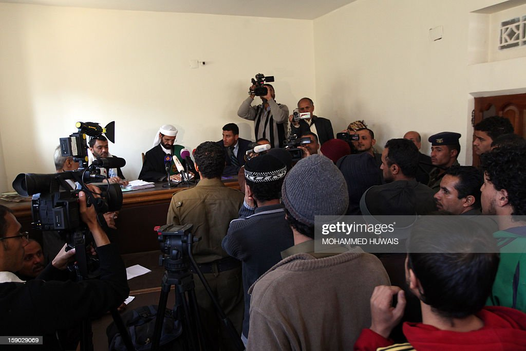 Suspected Yemeni al-Qaeda militants attend their sentencing hearing on January 6, 2013 at the state security court in the Yemeni capital Sanaa.