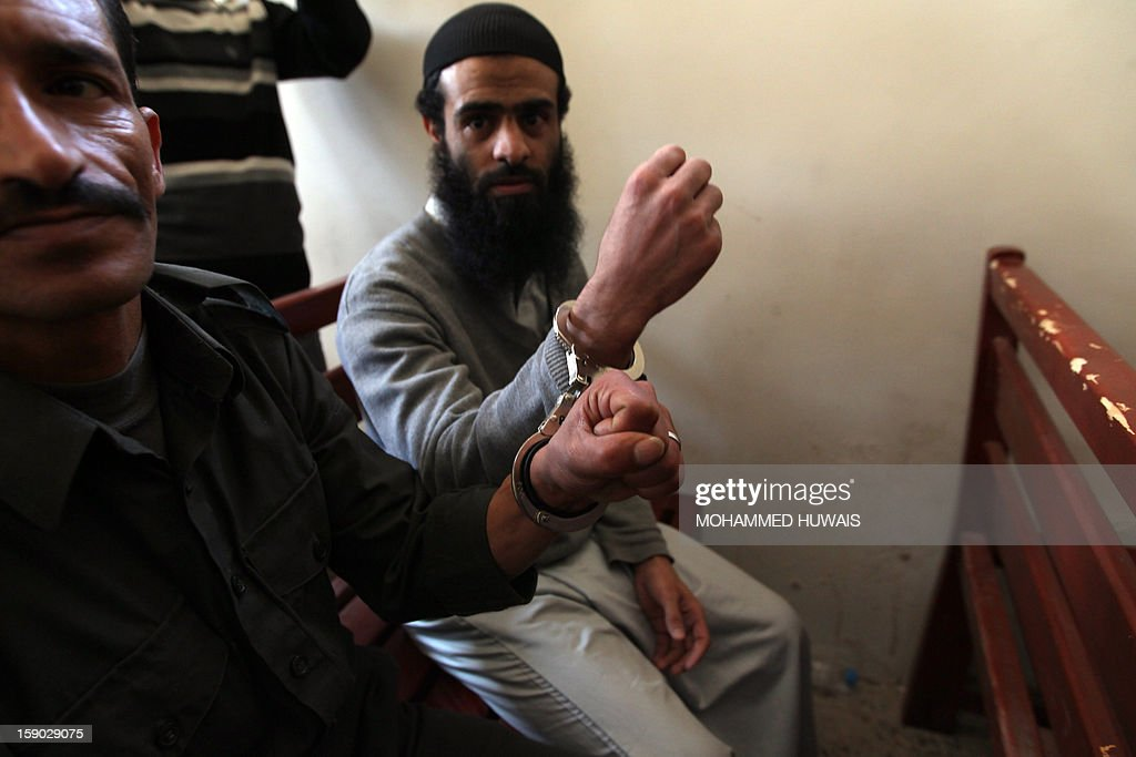 Suspected Yemeni al-Qaeda militants shows their handcuffs during their sentencing hearing on January 6, 2013 at the state security court in the Yemeni capital Sanaa.