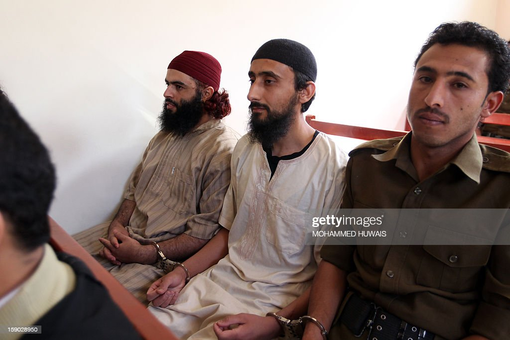 Suspected Yemeni al-Qaeda militants sit with handcuffs during the sentencing hearing on January 6, 2013 at the state security court in the Yemeni capital Sanaa. AFP PHOTO/ MOHAMMED HUWAIS