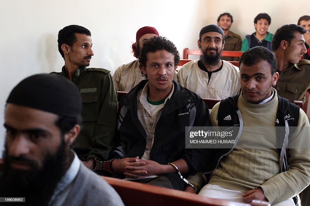 Suspected Yemeni al-Qaeda militants sit with handcuffs during their sentencing hearing on January 6, 2013 at the state security court in the Yemeni capital Sanaa.