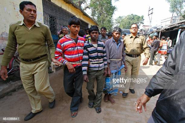 Suspects in a gangrape case are led by police to a district courthouse in Birdhum district near the village of Subalpur some 240 kilometres west of...