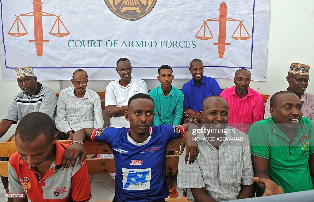 Suspects of the Daallo Airlines bomb attack claimed by the Al-Qaeda-linked Shebab look on during a Somali military court in Mogadishu, on May 30, 2016. A Somali military court jailed two men for life for their role in the Daallo Airlines bomb attack. Of 10 others also on trial in connection with the attack, five received up to four-year jail terms while the remainder were released after the court found them not guilty. The February 2 blast left a metre-wide (three-foot) hole in the fuselage of the Daallo Airlines plane shortly after it took off from Somalia's main airport in Mogadishu, killing only the suspected bomber and forcing an emergency landing. ABDIWAHAB