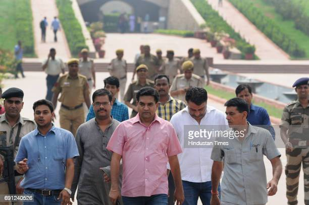 Suspended Aam Aadmi Party MLA Kapil Mishra leaves Rajghat Memorial for Mahatama Gandhi after paying tribute a day after he was roughed up in the...