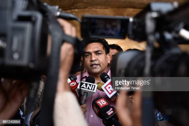 Suspended Aam Aadmi Party MLA Kapil Mishra talks to media at the Rajghat Memorial for Mahatama Gandhi a day after he was roughed up in the assembly...
