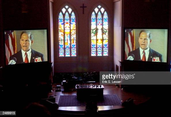 Suspended Alabama Chief Justice Roy Moore appears in a video presentation before speaking to parishoners at The Church of the Apostles September 7...
