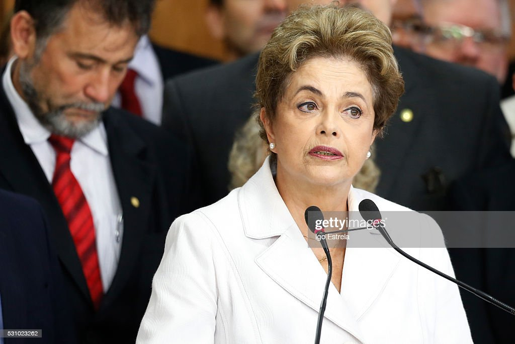 Suspended Brzilian President <a gi-track='captionPersonalityLinkClicked' href=/galleries/search?phrase=Dilma+Rousseff&family=editorial&specificpeople=1955968 ng-click='$event.stopPropagation()'>Dilma Rousseff</a> speaks to supporters at the Planalto presidential palace after the Senate voted to accept impeachment charges against Rousseff on May 12, 2016 in Brasilia, Brazil. Rousseff has been suspended from her presidential duties and will face a Senate trial for alleged manipulation of government accounts.