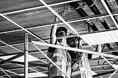 Workers seting up suspended ceiling frame