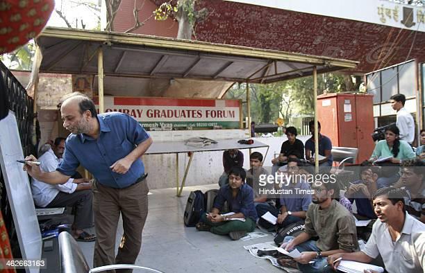 Suspended economics department professor of Mumbai University Neeraj Hatekar holds classes for his students outside the Mumbai University Kalina...