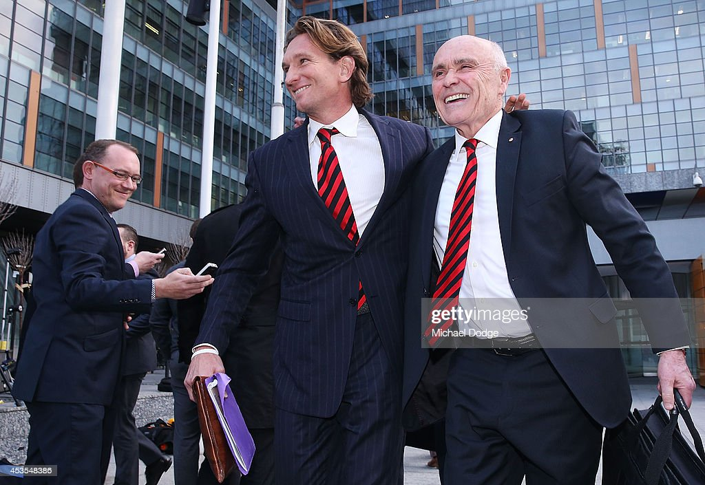 Suspended Essendon Bombers coach James Hird and Bombers President Paul Little embrace after their media conference at the Supreme Court at the finish...