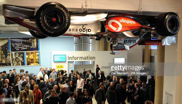 A suspended F1 racing car on display at the 'Fast Forward 20 Ways F1 is Changing our World' exhibition at the Science Museum in south west London