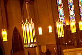 Suspended lights inside church.