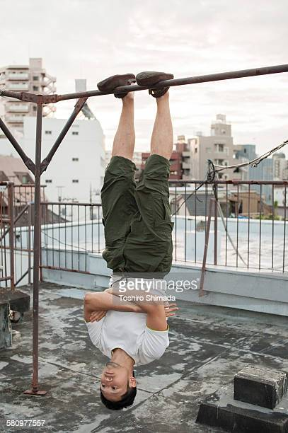 A suspended man upside down