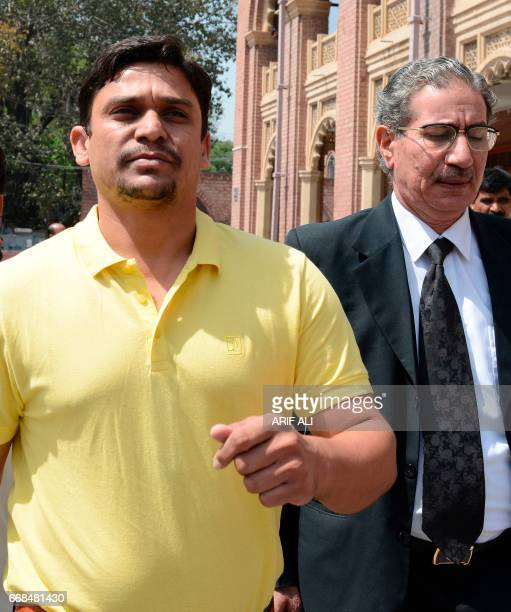Suspended Pakistani cricketer Khalid Latif and his lawyer leave the High Court building in Lahore on April 14 2017 Pakistan cricket authorities have...