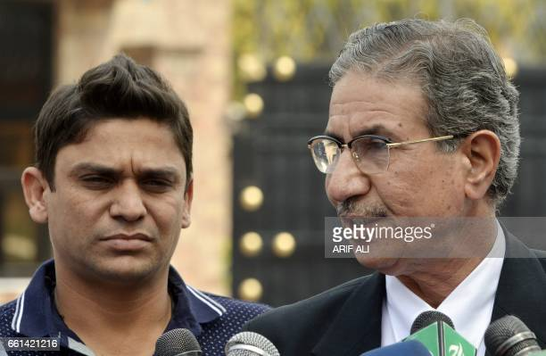 Suspended Pakistani cricketer Khalid Latif and his lawyer speak to media after appearing before a tribunal in Lahore on March 31 2017 Pakistan...