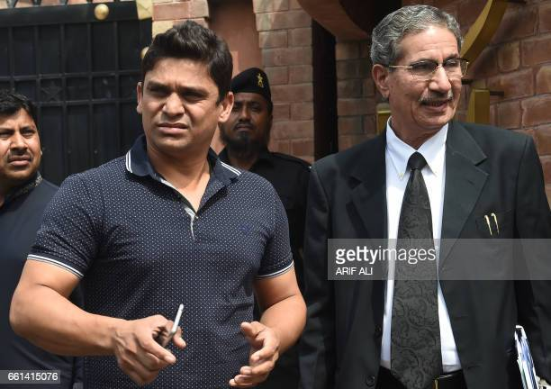 Suspended Pakistani cricketer Khalid Latif leaves with his lawyer after appearing before a tribunal in Lahore on March 31 2017 Pakistan batsman...