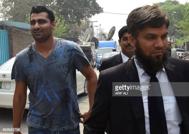 Suspended Pakistani cricketer Shahzaib Hasan arrives with his lawyer at Pakistan's Federal Investigation Agency to record his statement in Lahore on...