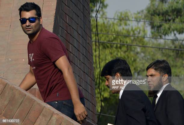 Suspended Pakistani cricketer Shahzaib Hasan arrives with his lawyers to appear before a tribunal in Lahore on March 31 2017 The Pakistan Cricket...