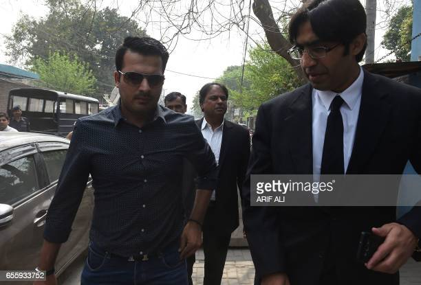 Suspended Pakistani cricketer Sharjeel Khan arrives with his lawyer at Pakistan's Federal Investigation Agency to record his statement in Lahore on...