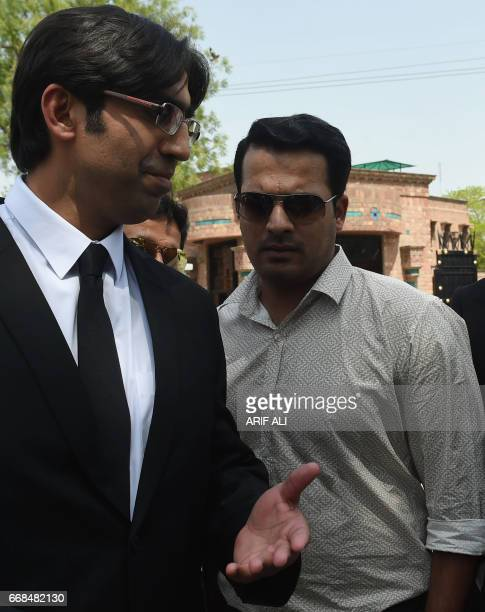 Suspended Pakistani cricketer Sharjeel Khan walks with his lawyer after appearing before a tribunal in Lahore on April 14 2017 Pakistan cricket...