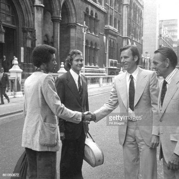 Suspended Yugoslav tennis star Nikki Pilic shaking hands with American player Arthur Ashe in the Strand when the highcourt hearing of his legal...