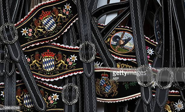 Suspenders for traditional Bavarian leather trousers decorated with stitched designs lay at the workshop of leather tailor Franz Stangassinger in...